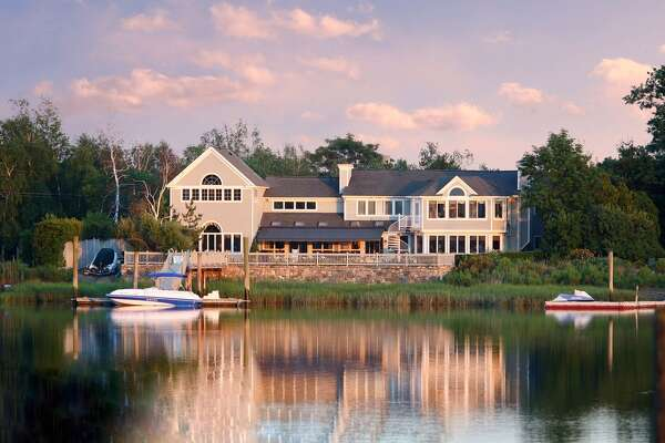 2 Surf Rd, Westport, CT 06880   4 beds 5 baths 7,243 sqft   Features: 103 ft. of protected water frontage on Bermuda lagoon, 40 ft. deep water dock and boat ramp   View full listing on Zillow