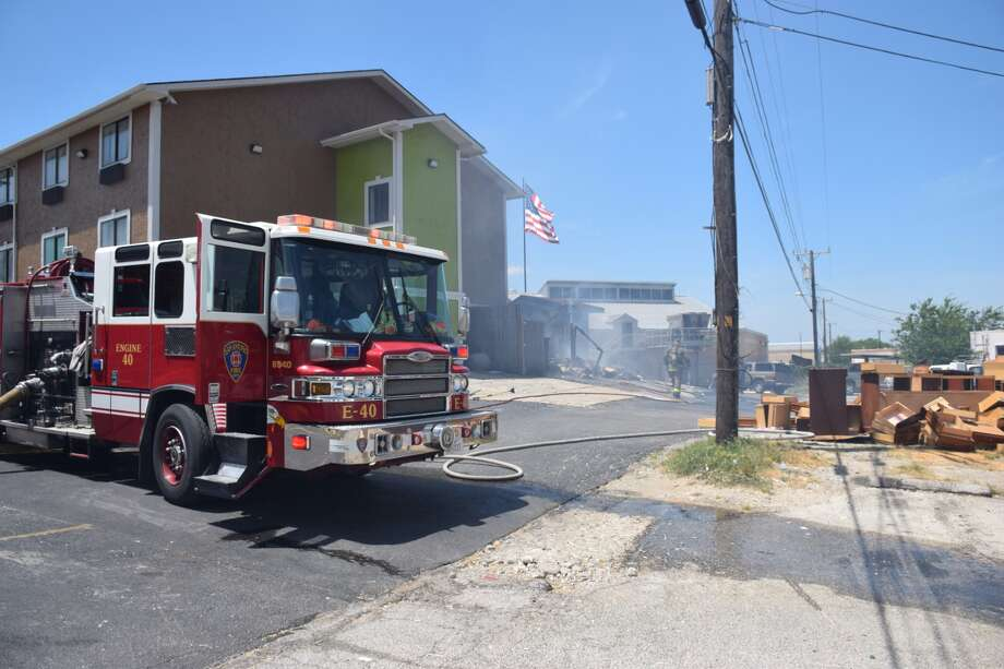 At least 13 San Antonio Fire Department units were called to a Super 8 Motel at Interstate 35 and Weidner Road to battle a fire, Tuesday afternoon, July 5, 2016. Photo: Mark D. Wilson