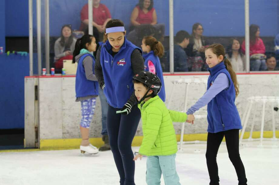 Sarah Rogers, Kevin Wu and Delaney Ross skate at the Sugar Land Ice and Sports Center.