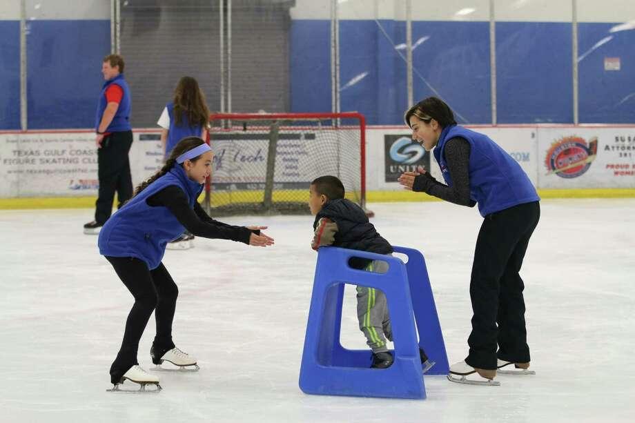 Jordan Virata, Tam Do and Maggie Agulera skate at the Sugar Land Ice and Sports Center.