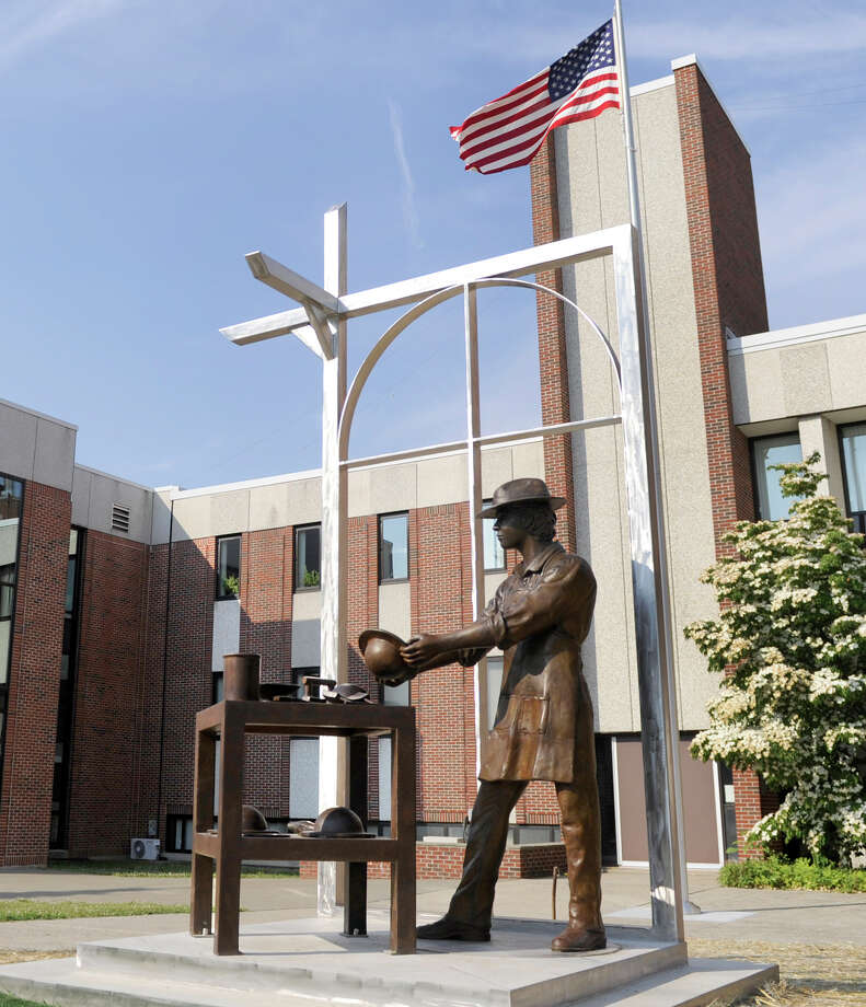 Hatters' Monument, standing on the grounds of Danbury City Hall, was unveiled Monday. Photo: Carol Kaliff / Hearst Connecticut Media / The News-Times