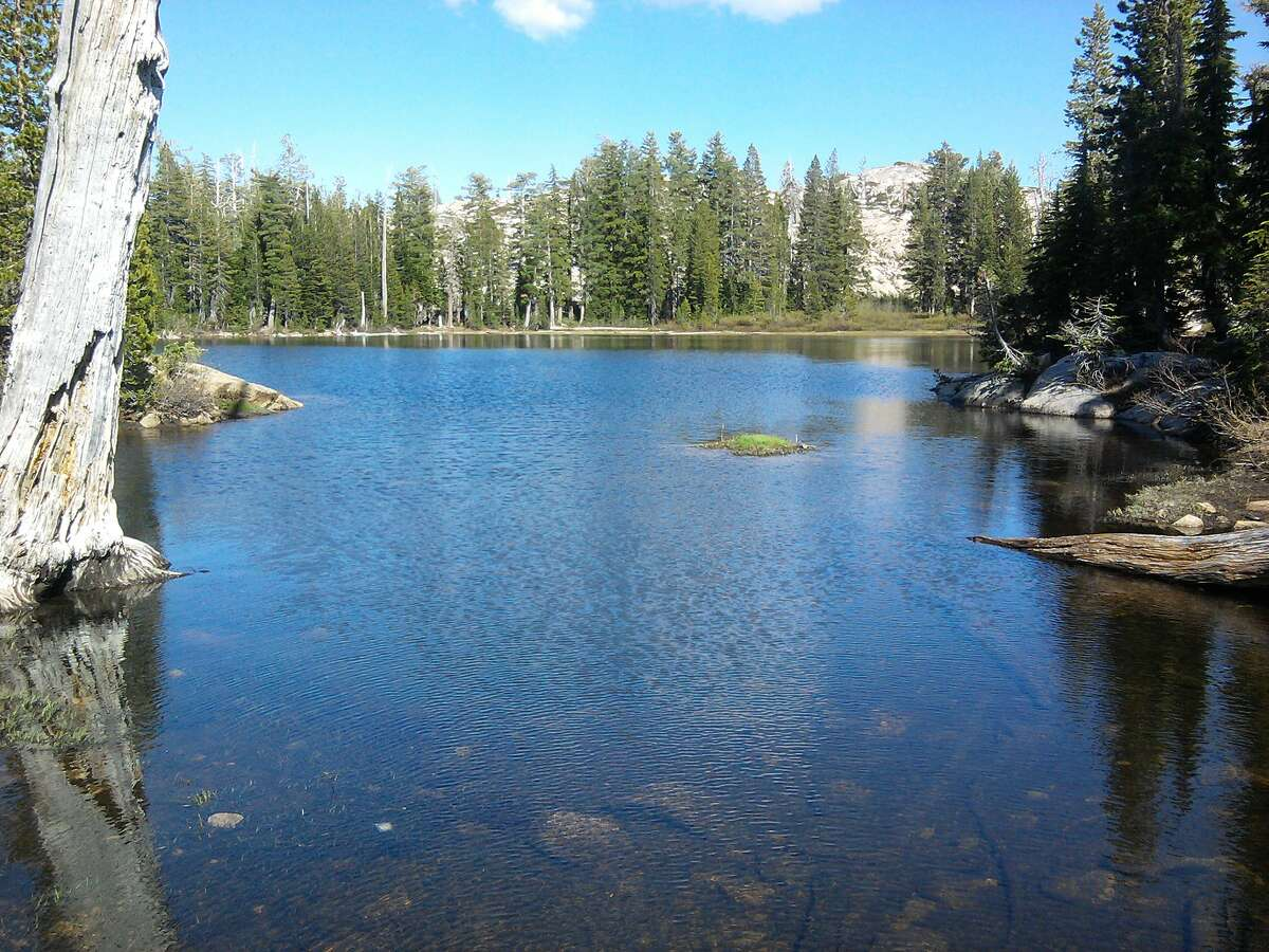 A 2.5-mile Five Lakes Trail from the trailhead near the Alpine Meadows Ski Area at North Tahoe leads over a ridge at 7,400 feet elevation, past the boundary of the Granite Chief Wilderness to a series of small, pretty lakes set in forest and often bordered by granite.