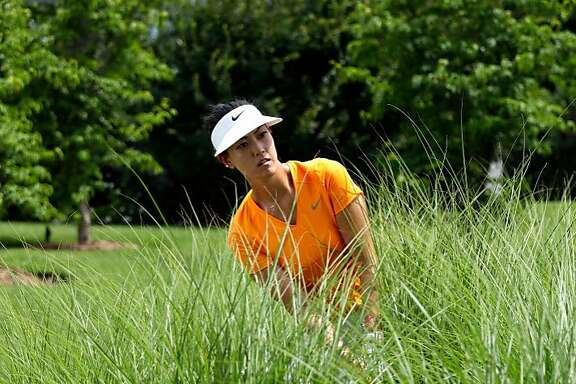 ROGERS, AR - JUNE 25:  Michelle Wie of the United States hits her second shot on the 18th hole from the bushes during the second round of the Walmart NW Arkansas Championship Presented by P&G on June 25, 2016 at Pinnacle Country Club in Rogers, Arkansas.  (Photo by Jamie Squire/Getty Images)