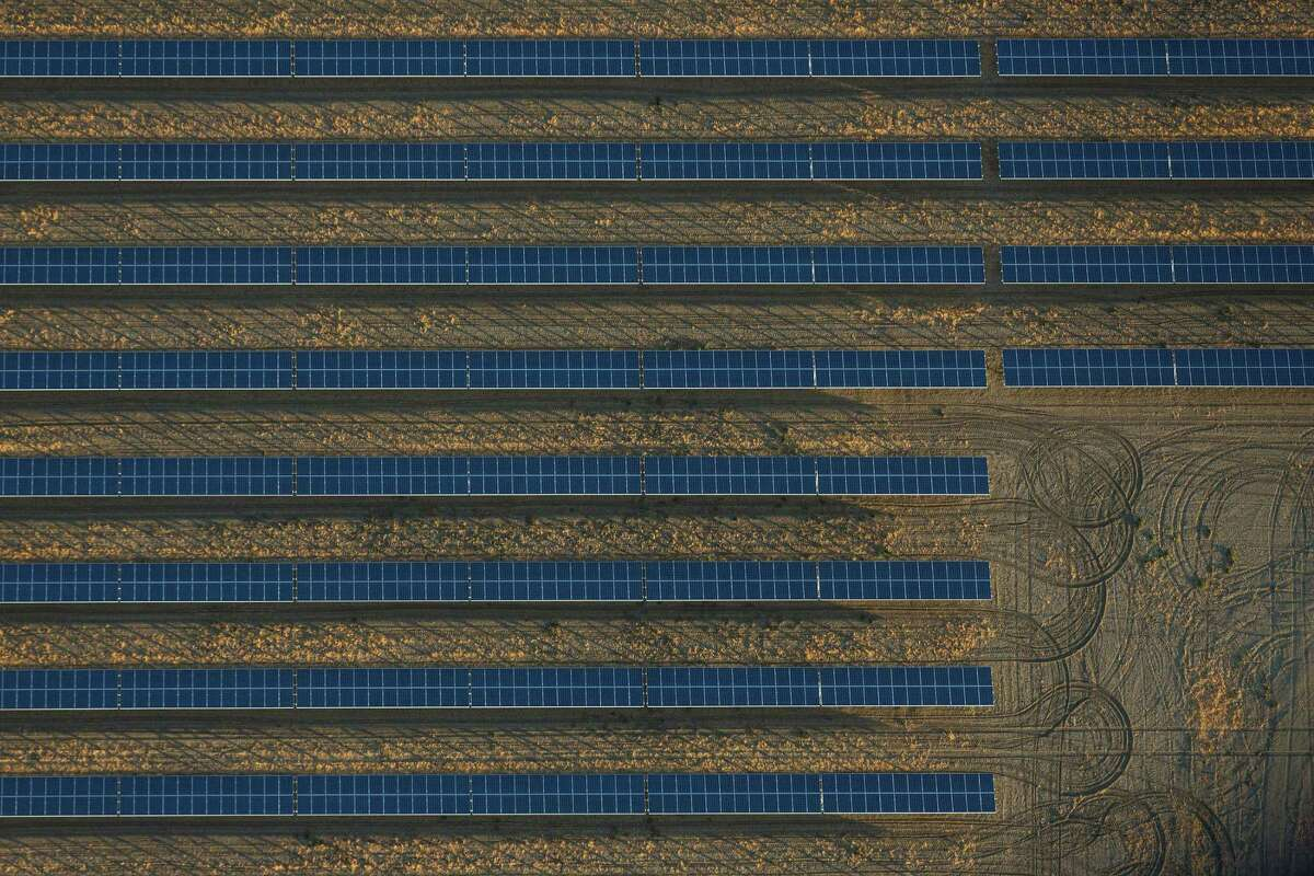 FILE -- Rows of solar panels cover a former agricultural plot in CaliforniaÂ?'s Central Valley, June 12, 2015. Though Hillary Clinton speaks often about climate change and has promised a sevenfold increase in solar energy panels, she avoids mention of one policy economists believe would be effective but that would require congressional assent Â?- a tax on carbon dioxide emissions. (Damon Winter/The New York Times)