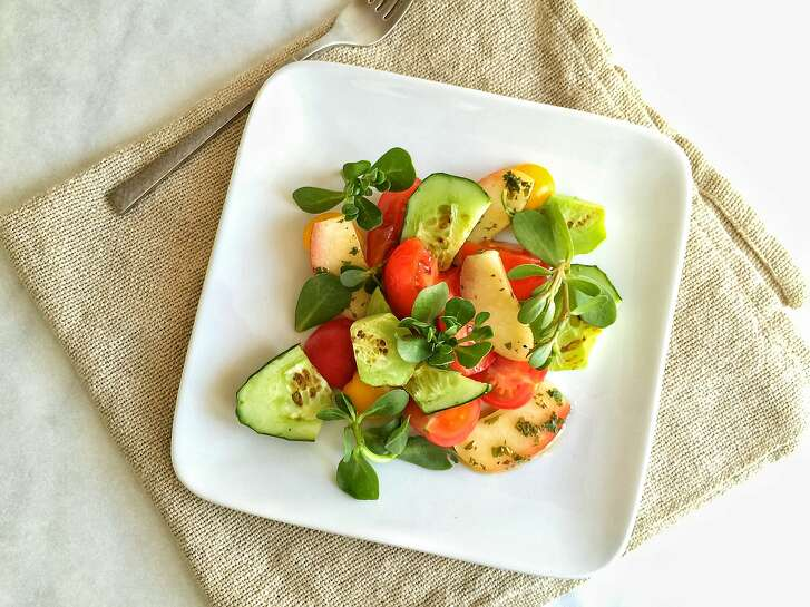 Compressed nectarine salad with cucumber, tomatoes and purslane