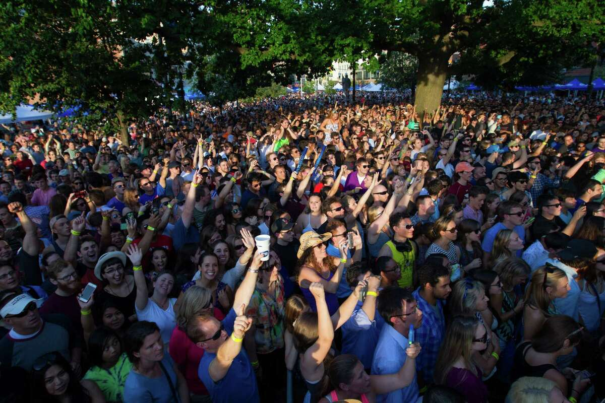 Music fans enjoy the Alive@Five entertainment series at Columbus Park in Stamford last year. This year's program kicks off Thursday, July 7, and runs through Thursday, Aug. 11. Click through to see this year's lineup and photos from last year's series.
