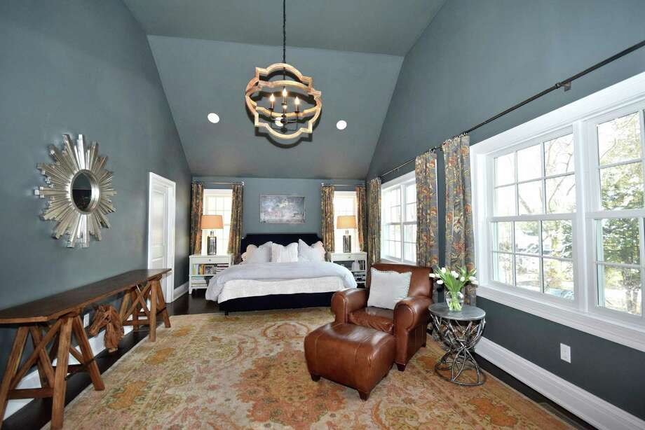 A wonderful first-floor master suite features cathedral ceilings with recessed lighting.