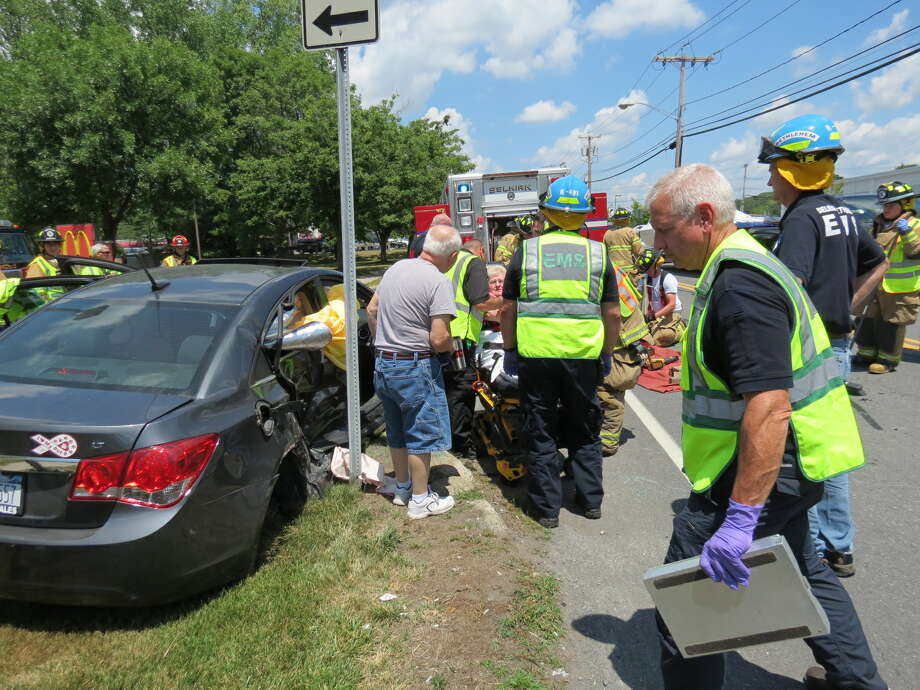 Rescue workers extricated Beverly Phillips from the passenger seat after an accident on Route 9W in Bethlehem.  (Thomas Heffernan Sr. / Special to the Times Union)