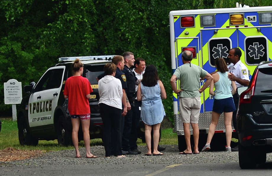 Norwalk police investigate an incident where a female juvenile said she was attacked on a trail behind Rowayton Woods Condominiums in Norwalk on Friday, July 1. Photo: Erik Trautmann / Hearst Connecticut Media / (C)2016, Norwalk Hour, all rights reserved