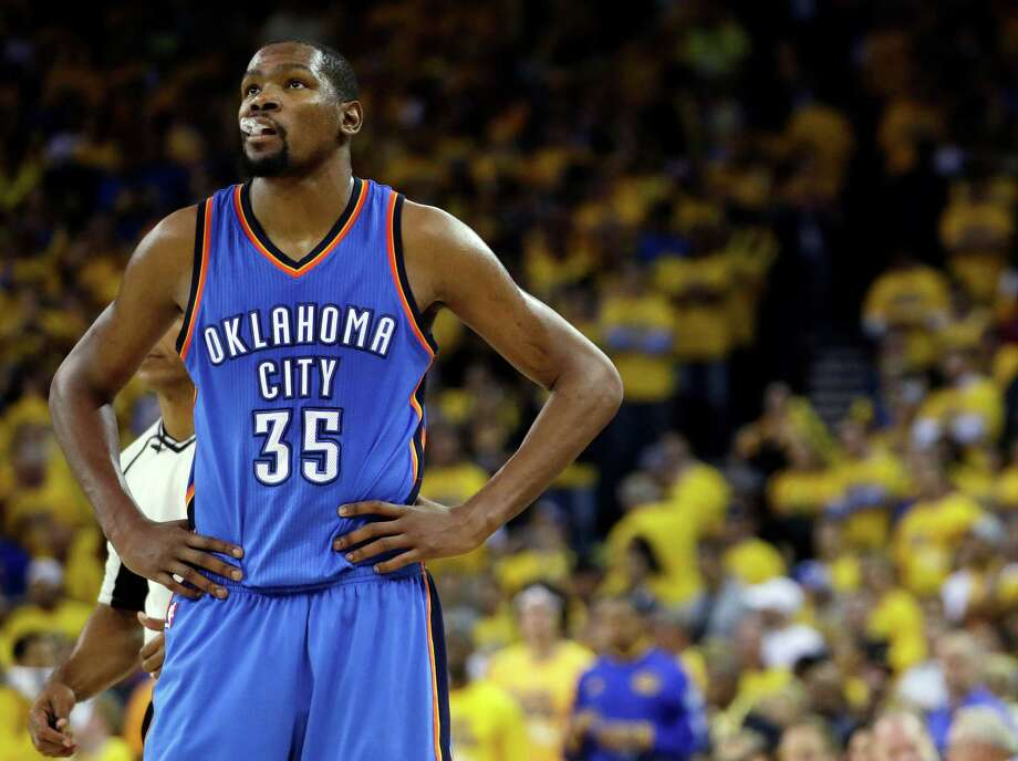 FILE - In this May 26, 2016, file photo, Oklahoma City Thunder's Kevin Durant watches during the closing minutes of the second half in Game 5 of the NBA basketball Western Conference finals against the Golden State Warriors in Oakland, Calif. Durant and others are ready to decide their NBA futures, with free agency beginning Friday, July 1, 2016. Teams have more cap room than ever, meaning this could be one of the more highly anticipated periods in league history.  (AP Photo/Marcio Jose Sanchez, File) Photo: Marcio Jose Sanchez, STF / AP