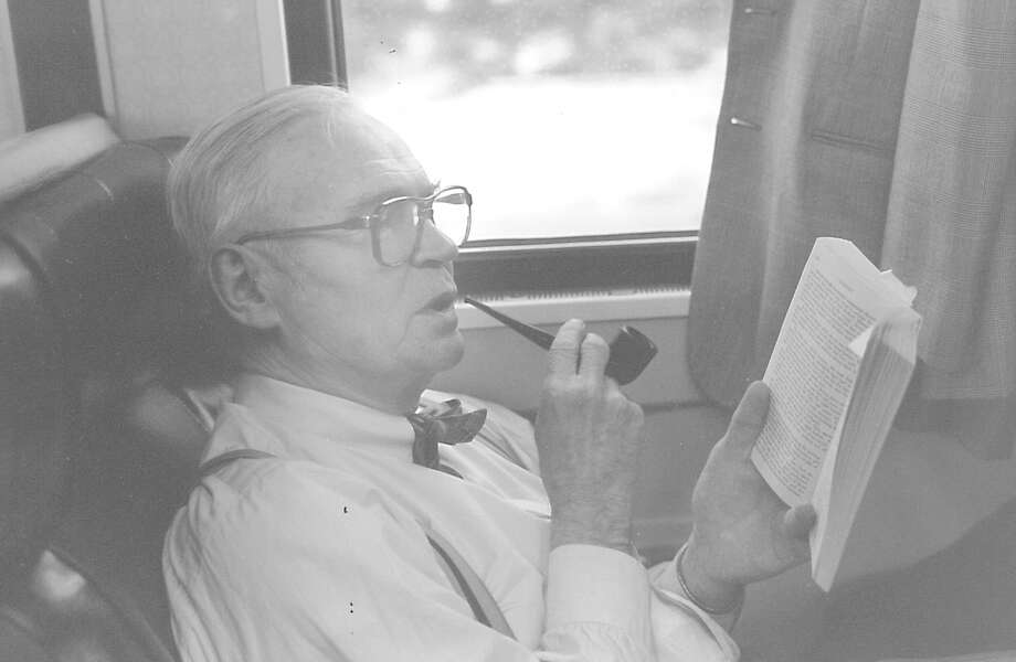 Riverside resident Wolcott Ely enjoying his pipe and a book on a Metro-North train on June 10, 1987. Metro-North had proposed a smoking ban on all cars for the end of that year. Photo: Mel Greer