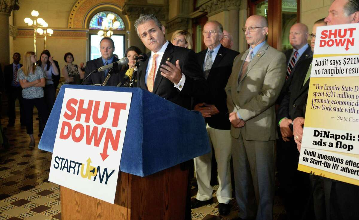 Former state Assemblyman Steve McLaughlin, center at podium, speaks at a news conference to call for the shut down of START-UP NY outside the Assembly Chamber Wednesday June 10, 2015 in Albany, NY. McLaughlin is now Rensselaer County executive. (John Carl D'Annibale / Times Union)