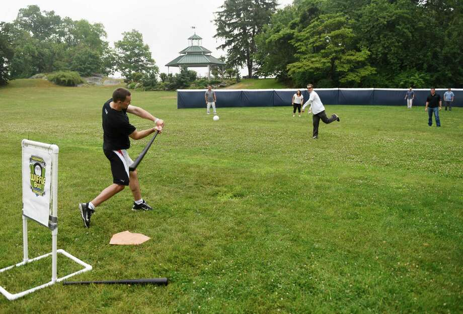 Faith Focus Finish CEO Brendan Micik hits a pitch during the dedication ceremony of the town's new wiffle ball field at Byram Park in the Byram section of Greenwich, Conn. Tuesday, July 5, 2016. The Ninth Annual Greenwich Wiffle Ball Tournament to raise money for Kids in Crisis will take place July 23, featuring 64 teams and 10 trophy winners. Photo: Tyler Sizemore / Hearst Connecticut Media / Greenwich Time