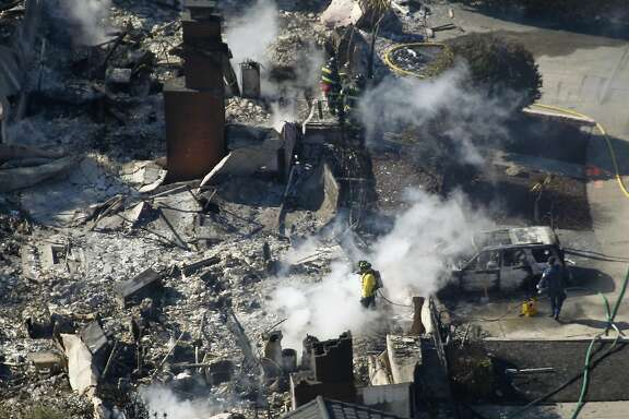 Fire crews put out hot spots at a home in San Bruno, Calif. on Friday, Sept. 10, 2010 that was destroyed after a massive natural gas pipeline explosion the night before.