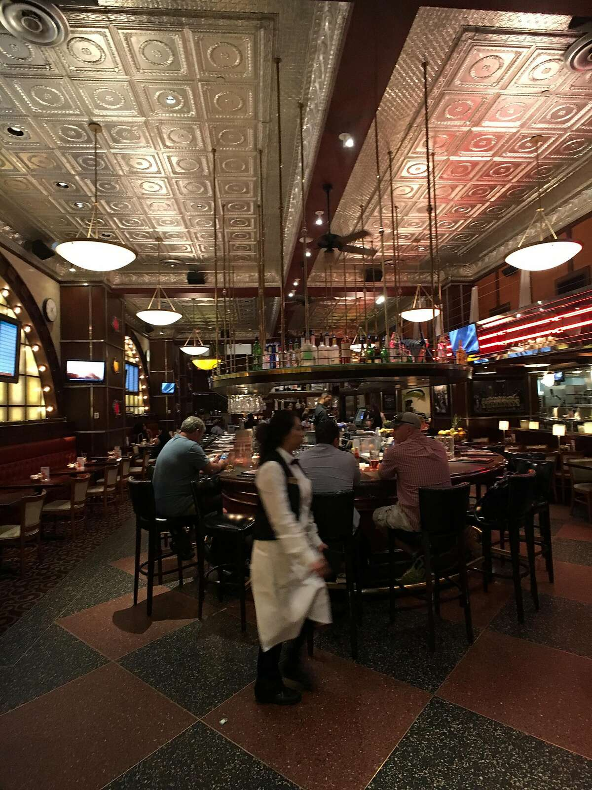 Customers dine at Pappadeaux Seafood Kitchen inside Dallas/Fort Worth International Airport.