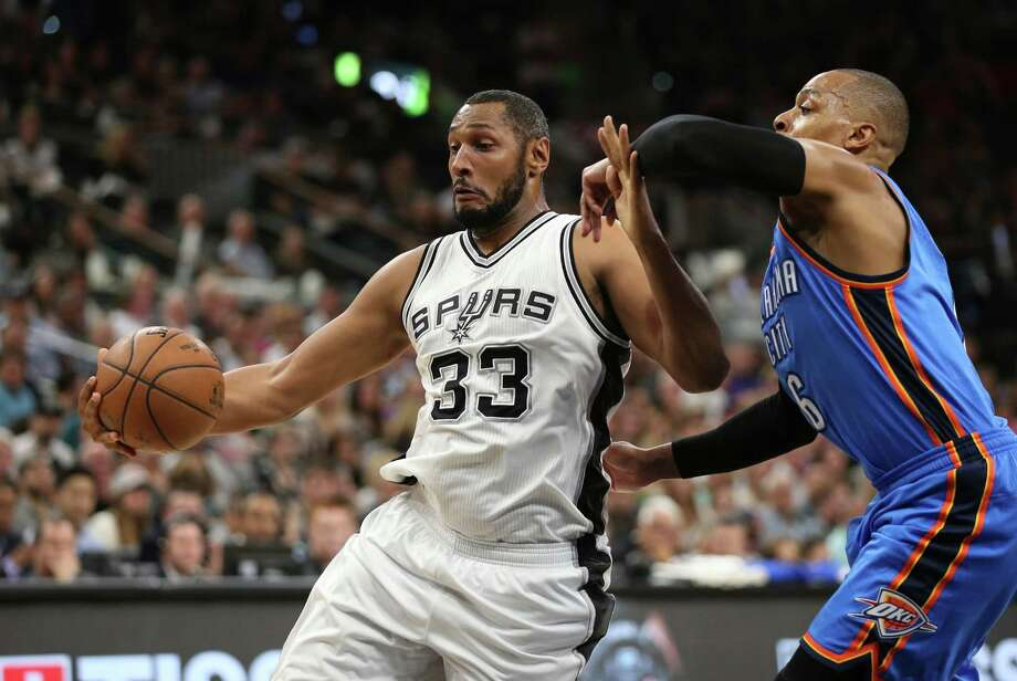 Spurs' Boris Diaw keeps the ball away from Oklahoma City Thunder's Randy Foye in the first half of Game 5 in the Western Conference semifinals at the AT&T Center on May 10, 2016. Photo: Jerry Lara /San Antonio Express-News / © 2016 San Antonio Express-News