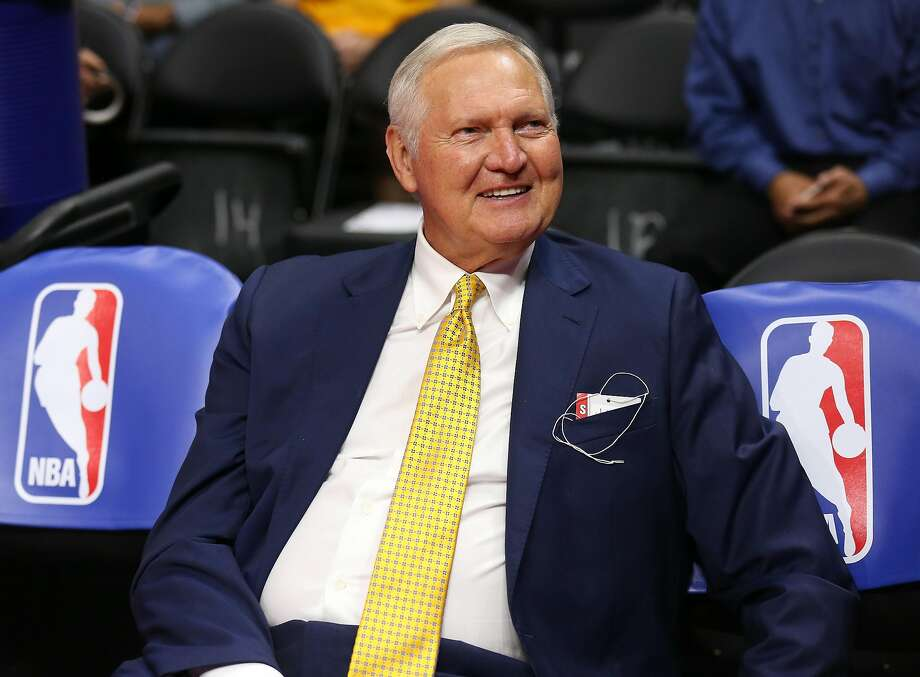 Warriors adviser  Jerry West before a game at Staples Center, sitting on bench seats decorated with the NBA logo he inspired. Photo: Stephen Dunn, Getty Images