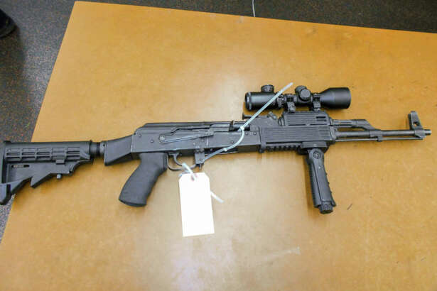 Seattle police say they seized this assault rifle from behind a washing machine after witnesses spotted someone firing the gun into the air in West Seattle after a home fireworks show Monday night. A 29-year-old felon admitted to shooting the gun and was arrested for illegal firearm possession.