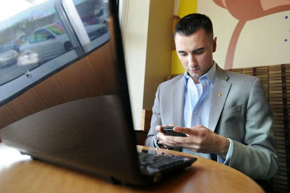 Bill Cortese, 23, of Danbury, the political director for Tom Foley's campaign for governor, checks his BlackBerry while at a local coffee shop, Monday, April 19, 2010.