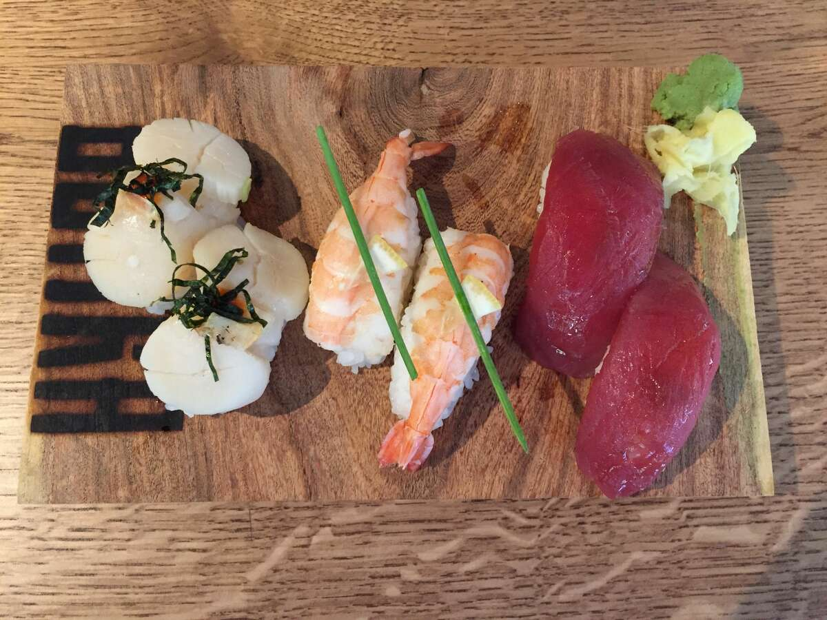 This nigiri trio at Botika features scallops, shrimp and tuna with wasabi and house-pickled ginger.
