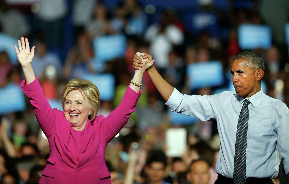 """President Barack Obama joined Hillary Clinton for the first time on the campaign trail Tuesday in Charlotte, N.C. """"There has never been any man or woman more qualified for this office,"""" he said."""
