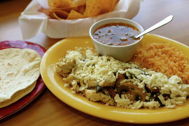 L-Taco Mexican Cafe's chicken poblano is topped with sauted mushrooms and queso fresco.