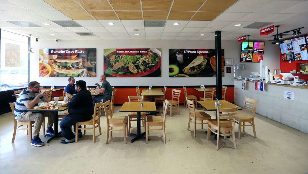 L-Taco Mexican Cafe displays large photos of its wide array of menu items.