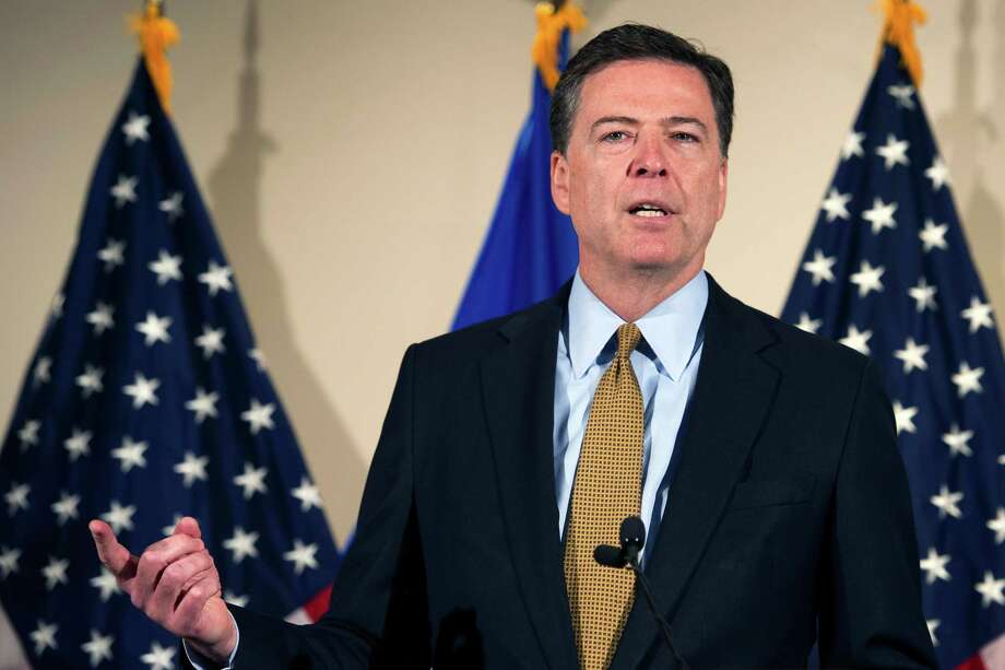 FBI Director James Comey makes a statement at FBI Headquarters in Washington, Tuesday, July 5, 2016. Comey said 110 emails sent or received on Hillary Clinton's server contained classified information. (AP Photo/Cliff Owen) ORG XMIT: DCCO102 Photo: Cliff Owen / Cliff Owen