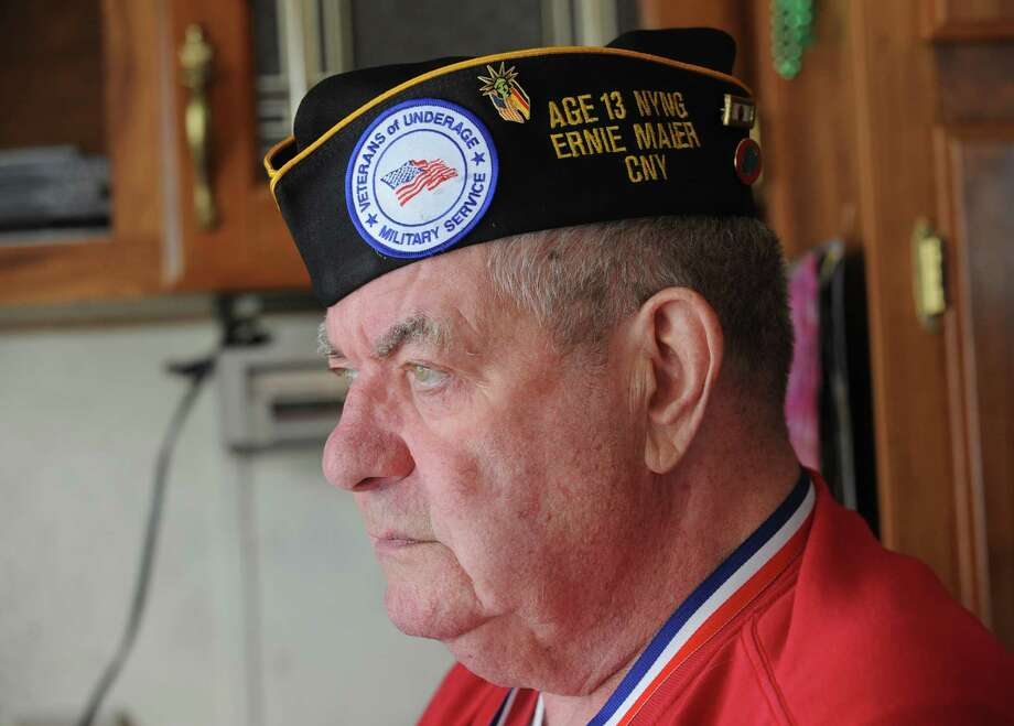 Veteran Ernest Maier wears his veteran's hat with a Veterans of Underage Military Service (VUMS) patch at his home on Thursday, June 30, 2016 in Averill Park, N.Y. Maier lied about his age and enlisted in the National Guard at 13 in 1946 and served in the Korean War. He was just elected NYS commander of the VUMS, a national group Veterans of Underage Military Service about soldiers who fibbed about their age in order to serve their country. (Lori Van Buren / Times Union) Photo: Lori Van Buren / 20037177A