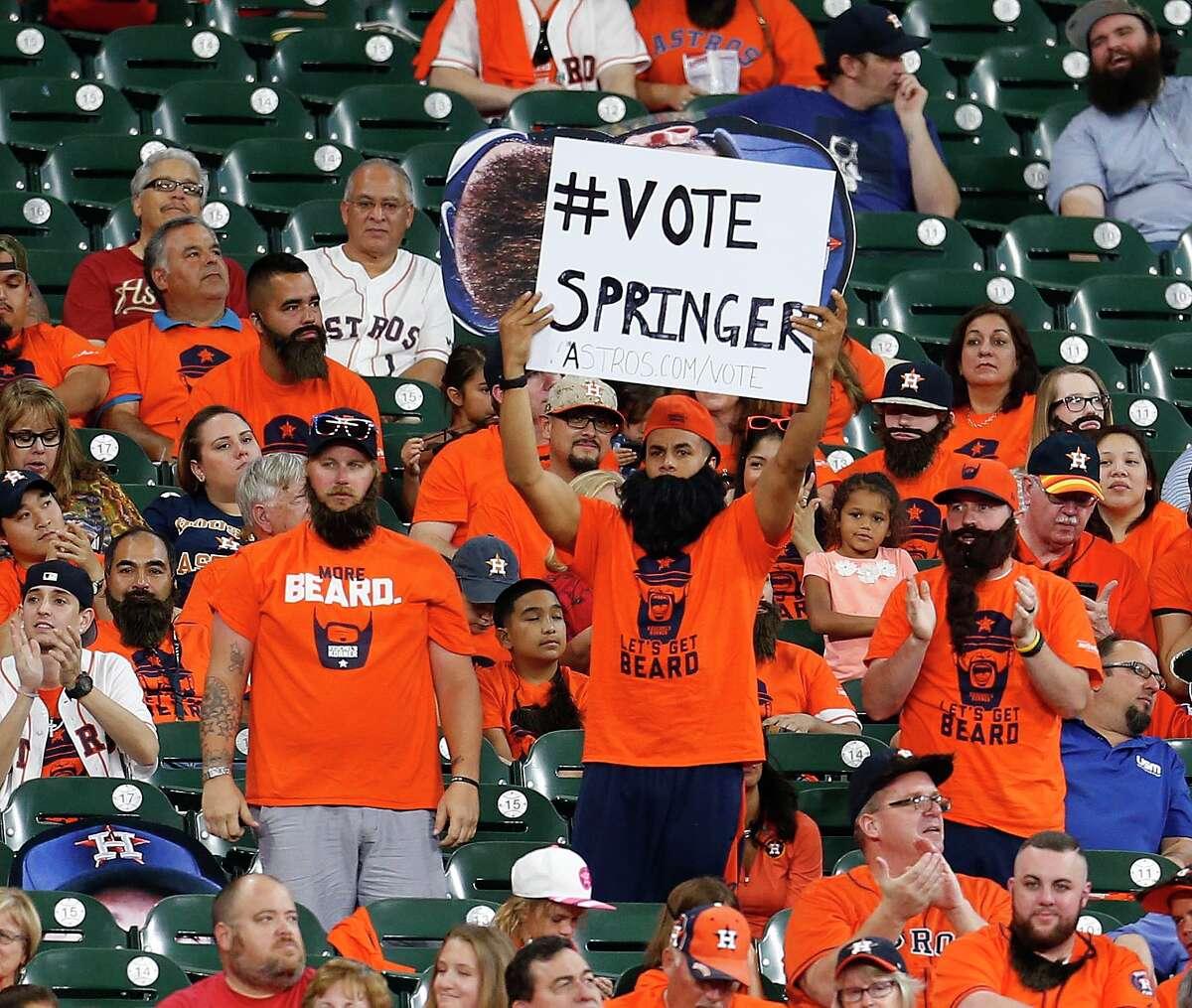 Houston Astros right fielder George Springer fans in the Keuchel Korner hold a sign for him during the third inning of an MLB baseball game at Minute Maid Park, Sunday, July 3, 2016, in Houston. ( Karen Warren / Houston Chronicle )