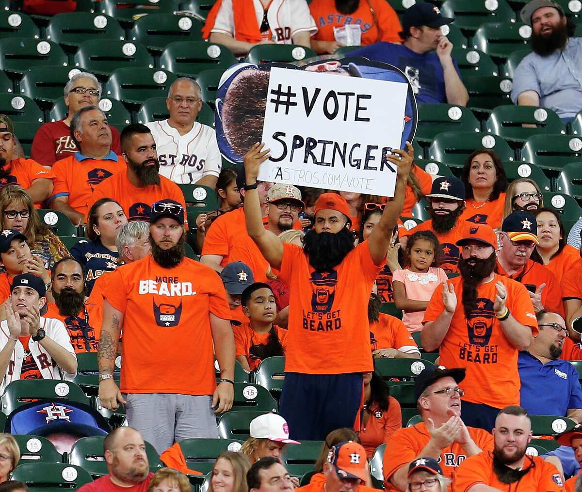 Houston Astros right fielder George Springer fans in the Keuchel Korner hold a sign for him during the third inning of an MLB baseball game at Minute Maid Park, Sunday, July 3, 2016, in Houston.