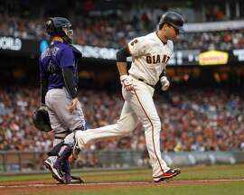 San Francisco Giants' Buster Posey walks in 1st inning against Colorado Rockies during MLB game at AT&T Park in San Francisco, Calif., on Tuesday, July 5, 2016.