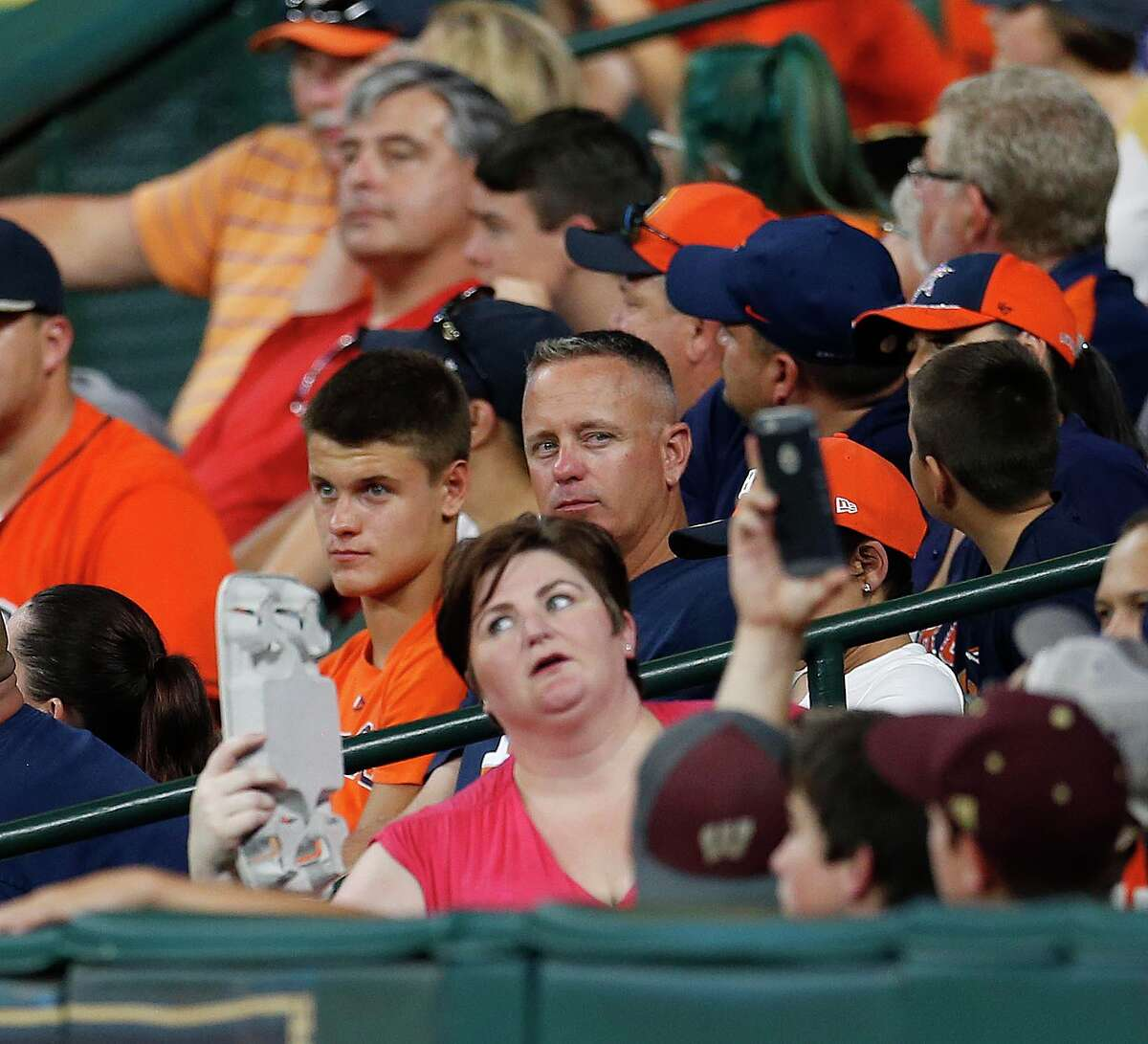 A toasty night in Minute Maid Park due to a malfunctioning of the air conditioning system leads one woman to fan herself in the seventh,