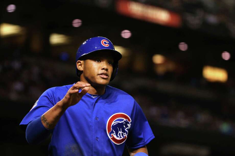 PHOENIX, AZ - APRIL 07:  Addison Russell #27 of the Chicago Cubs scores a fourth inning run against the Arizona Diamondbacks during the MLB game at Chase Field on April 7, 2016 in Phoenix, Arizona.  (Photo by Christian Petersen/Getty Images) ORG XMIT: 607675137 Photo: Christian Petersen / 2016 Getty Images