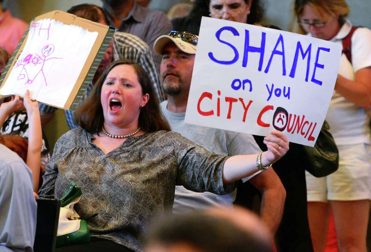 Black Rock resident Joanna Wesson protests with hundreds of other residents from that neighborhood over a raise in property taxes, during the Bridgeport City Council's meeting at Bridgeport City Hall in Bridgeport, Conn. on Tuesday July 5, 2016. High profile residents including former U.S. Comptroller General David Walker and former mayoral candidate Mary-Jane Foster were on hand to protest the hike as well.