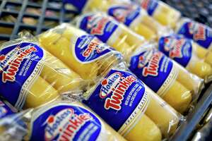 The owners of Hostess Brands announced Tuesday that they had agreed to sell a majority stake in the company to a publicly traded affiliate of the Gores Group, an investment firm, for about $725 million.