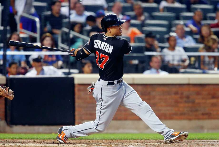 NEW YORK, NY - JULY 05:  Giancarlo Stanton #27 of the Miami Marlins follows through on a seventh inning two run home run against the New York Mets at Citi Field on July 5, 2016 in the Flushing neighborhood of the Queens borough of New York City.  (Photo by Jim McIsaac/Getty Images) ORG XMIT: 607681135 Photo: Jim McIsaac / 2016 Getty Images