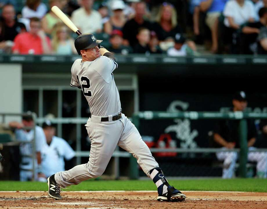 New York Yankees third baseman Chase Headley watches his two run homerun during the third inning of a baseball game against the Chicago White Sox in Chicago, on Tuesday, July 5, 2016. (AP Photo/Jeff Haynes) ORG XMIT: CXS106 Photo: Jeff Haynes / FR171008 AP