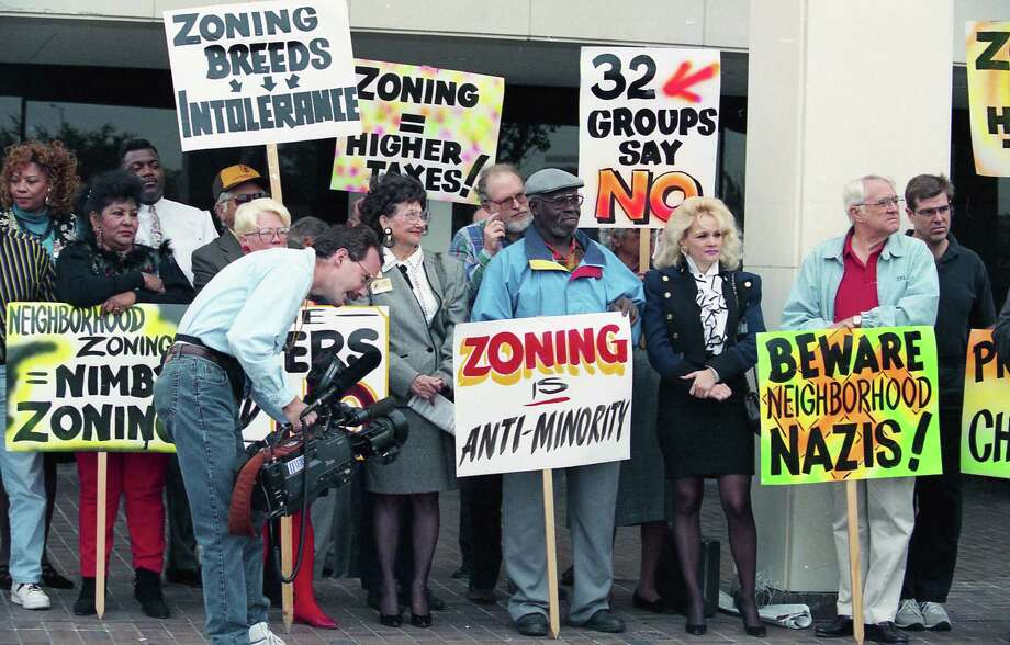 In November 1994, about 40 zoning opponents rallied at the Houston City Hall Annex to warn advocates of a proposal for neighborhood zoning that the voters had already spoken on the issue. Photo: John Everett, HC Staff / Houston Chronicle