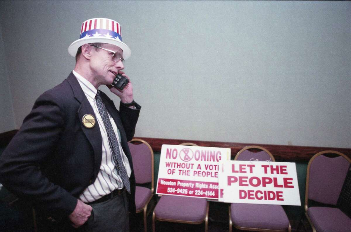 11/02/1993 - Barry Klein, executive director of the anti-zoning Houston Property Rights Association, talks on the phone Tuesday night awaiting election results for the proposed zoning ordinance, The land-control measure was rejected by voters in a tightly contested race.