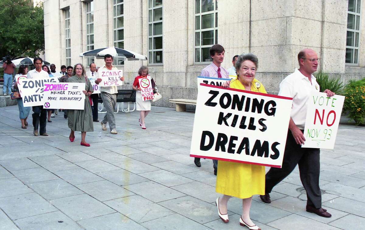 08/24/1993 - Anti-zoning group holds demonstration around Houston City Hall against the proposed Houston zoning ordinance city council is considering on Wednesday.