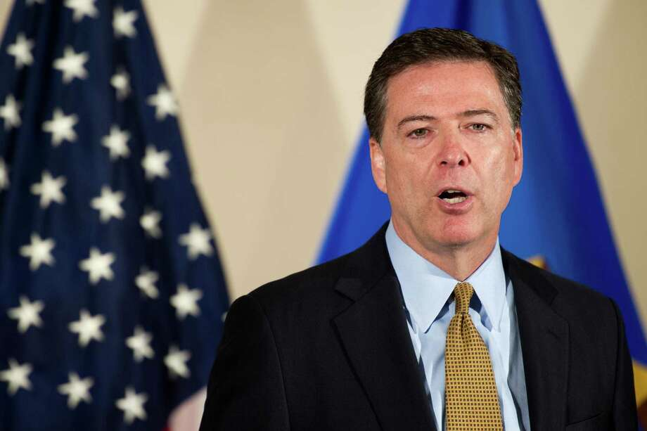 FBI Director James Comey provided a confusing explanation of teh decision not recommend charges against Hillary Clinton for her handling of top secret emails. Photo: Cliff Owen /Associated Press / Cliff Owen