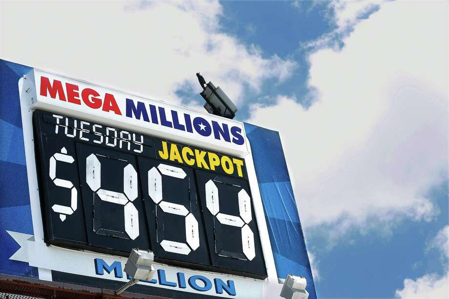 An electronic billboard displays the  Mega Millions jackpot on Tuesday, July 5, 2016. (AP Photo/Seth Perlman) Photo: Seth Perlman / Copyright 2016 The Associated Press. All rights reserved. This m