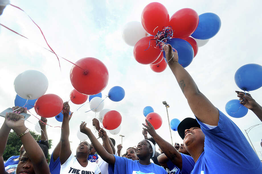 Family, including daughter Ruby Sampson (at right), release balloons as they gather Tuesday at the Gulfway Drive location of a drunk driving accident that claimed the life of Pamela Gail Fields a year ago Tuesday. Ms. Fields was killed when the driver of a vehicle in which she and two other women lost control of her vehicle on the busy thoroughfare through Port Arthur. The gathering released 51 balloons, the age Ms. Fields would have been on her birthday one day later. The memorial was done not only in remembrance of Ms. Fields, but also as a means of raising community awareness to the problem of drunk driving. The case against the driver is still pending indictment by the Jefferson County District Attorney's office. Photo taken Tuesday, July 5, 2016 Kim Brent/The Enterprise Photo: Kim Brent / Beaumont Enterprise