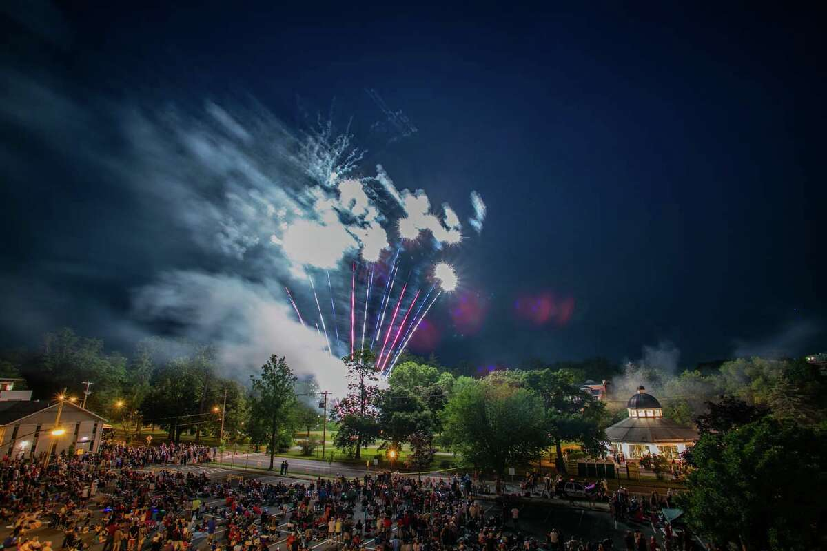 Fireworks alight the sky above Congress Park in Saratoga Springs on Monday, July 4, 2016.