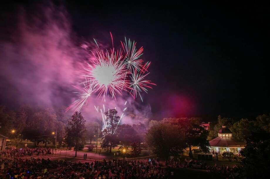 Fireworks alight the sky above Congress Park in Saratoga Springs on Monday, July 4, 2016. Photo: Dave Bigler Www.davebigler.com