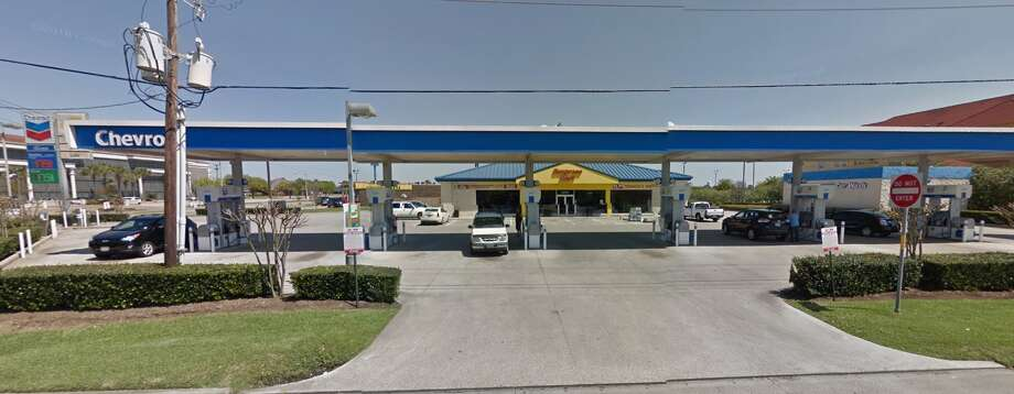 An off-duty security guard fired at the tires of a vehicle occupied by two suspected beer thieves at the Exxpress Mart on Jimmy Johnson Boulevard in Port Arthur early Saturday. Passenger Shalala Fletcher, 36, was hit by a bullet and died, according to Port Arthur Police Department. Photo: Google Maps