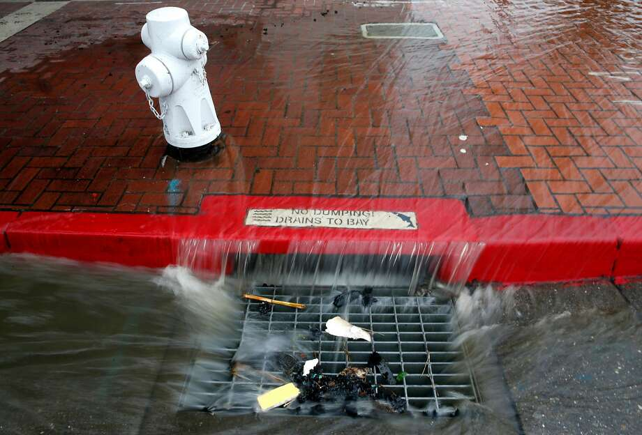 Residents in San Francisco can adopt drains like this and keep them cleared to avoid rainy-day situations like this. Photo: Paul Chinn / The Chronicle