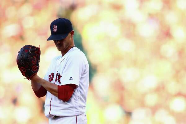 BOSTON, MA - JULY 02:  Clay Buchholz #11 of the Boston Red Sox prepares to pitch against the Los Angeles Angels during the first inning at Fenway Park on July 2, 2016 in Boston, Massachusetts.  (Photo by Maddie Meyer/Getty Images)