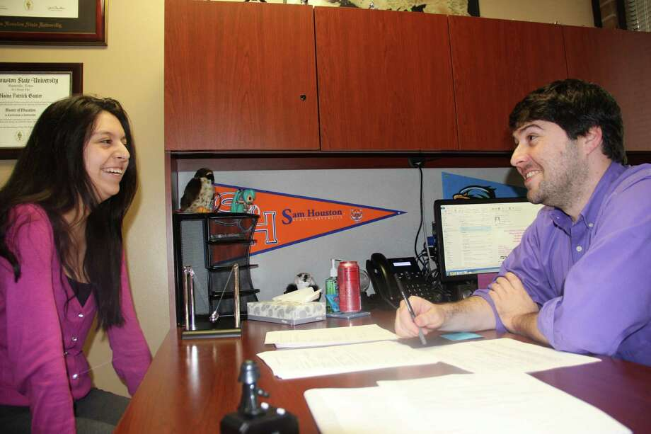 Blaine Ganter, right, new student success coach at College of the Mainland, meets with Julie Arenas-Purvinis.